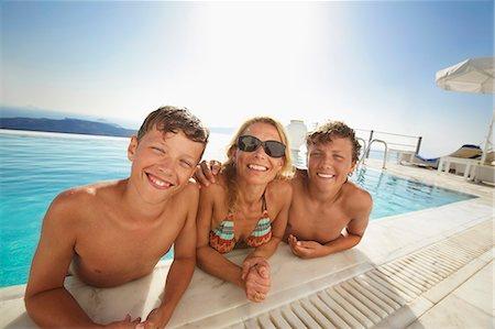 Family smiling in swimming pool Stock Photo - Premium Royalty-Free, Code: 649-06001747