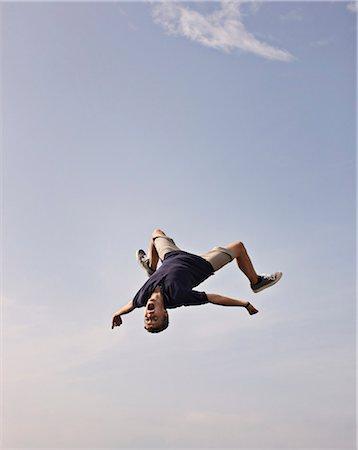 people falling - Teenage boy posing in mid-air Stock Photo - Premium Royalty-Free, Code: 649-06001766