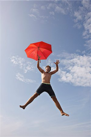 Teenage boy posing in mid-air Stock Photo - Premium Royalty-Free, Code: 649-06001768