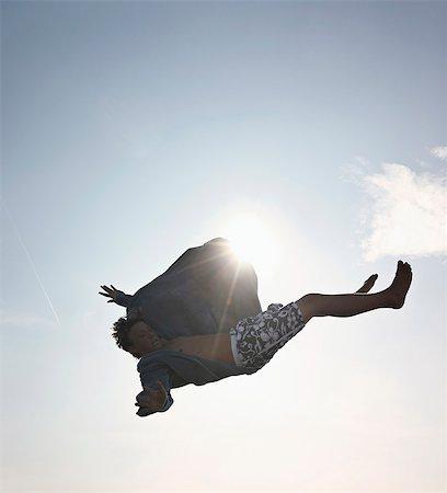 people falling - Teenage boy posing in mid-air Stock Photo - Premium Royalty-Free, Code: 649-06001769