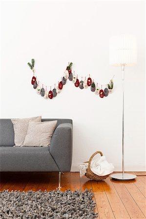 Advent calendar on living room wall Stock Photo - Premium Royalty-Free, Code: 649-06001797