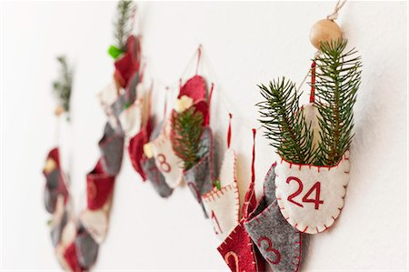 Close up of advent calendar on wall Stock Photo - Premium Royalty-Free, Code: 649-06001798