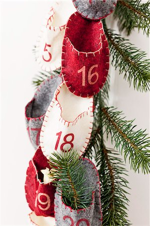 Advent calendar hanging from wall Stock Photo - Premium Royalty-Free, Code: 649-06001805