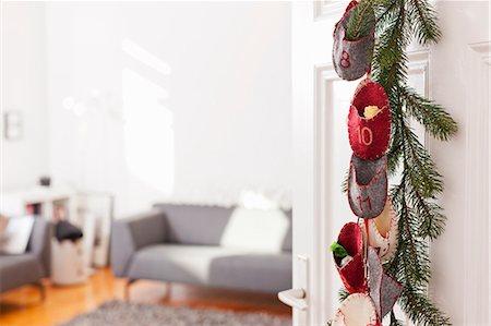Advent calendar hanging on door Stock Photo - Premium Royalty-Free, Code: 649-06001806
