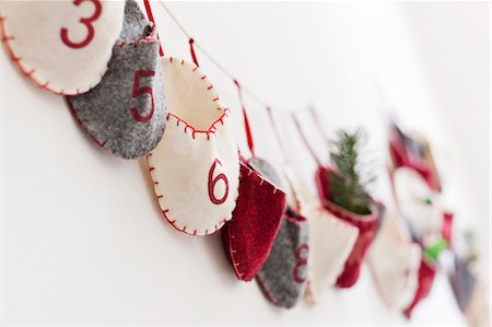 Close up of advent calendar on wall Stock Photo - Premium Royalty-Free, Code: 649-06001800