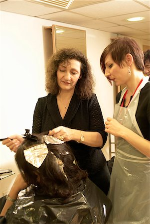 Hair stylist teaching student in salon Stock Photo - Premium Royalty-Free, Code: 649-06001829