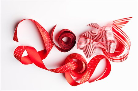 Close up of decorative red ribbons Stock Photo - Premium Royalty-Free, Code: 649-06001822