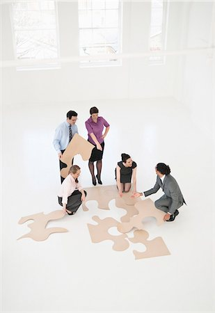 Business people doing puzzle in office Stock Photo - Premium Royalty-Free, Code: 649-06001898