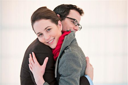 Smiling couple hugging Stock Photo - Premium Royalty-Free, Code: 649-06001913