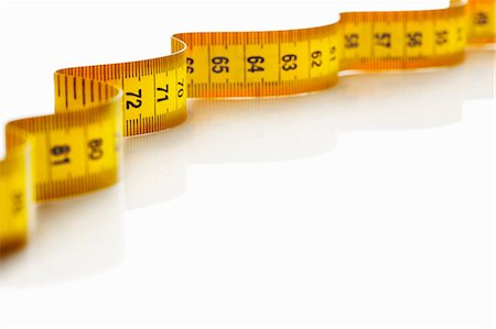 Close up of measuring tape Stock Photo - Premium Royalty-Free, Code: 649-06002005