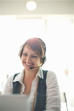sale - Businesswoman wearing headset at desk Stock Photo - Premium Royalty-Free, Code: 649-06039952