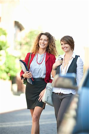 person walking on parking lot - Businesswomen walking together Stock Photo - Premium Royalty-Free, Code: 649-06039964