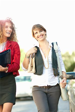 person walking on parking lot - Businesswomen walking together Stock Photo - Premium Royalty-Free, Code: 649-06039963