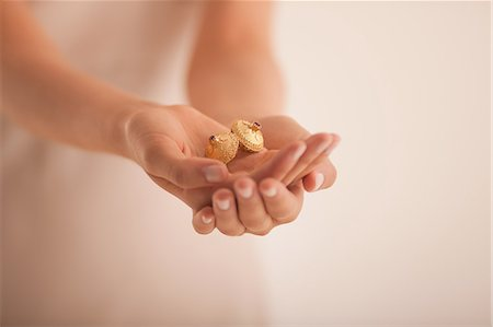 expensive jewelry - Woman holding golden ornaments Stock Photo - Premium Royalty-Free, Code: 649-06040018