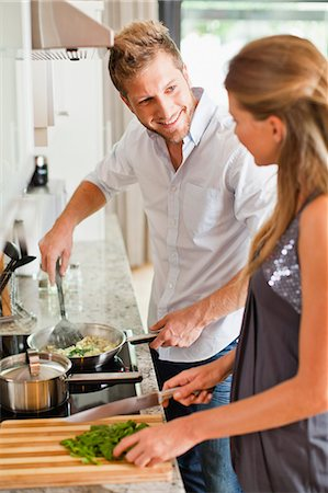 stove - Couple cooking together in kitchen Stock Photo - Premium Royalty-Free, Code: 649-06040118