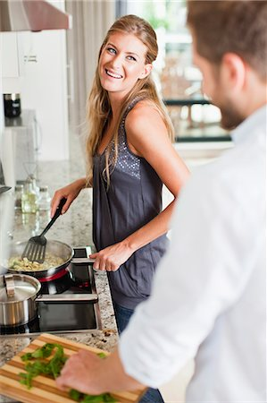 stove - Couple cooking together in kitchen Stock Photo - Premium Royalty-Free, Code: 649-06040120
