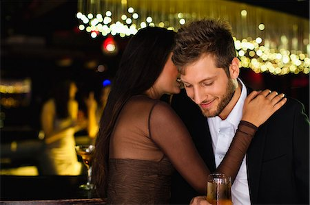 flirting - Smiling couple whispering at bar Stock Photo - Premium Royalty-Free, Code: 649-06040186