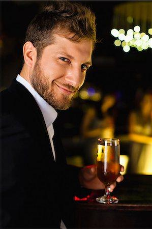 Smiling man having drink at bar Stock Photo - Premium Royalty-Free, Code: 649-06040183