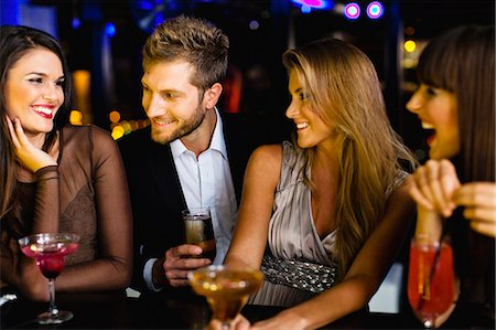 flirting - Man talking to women at bar Stock Photo - Premium Royalty-Free, Code: 649-06040193