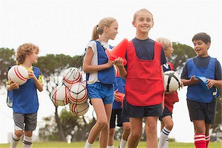 Children walking on soccer pitch Stock Photo - Premium Royalty-Free, Code: 649-06040283