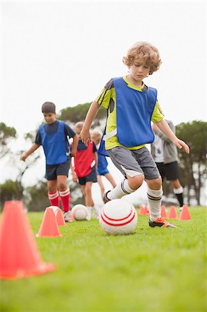 female playing soccer - Childrens soccer team training on pitch Stock Photo - Premium Royalty-Free, Code: 649-06040294