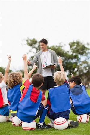 practise - Children raising hands during practice Stock Photo - Premium Royalty-Free, Code: 649-06040308