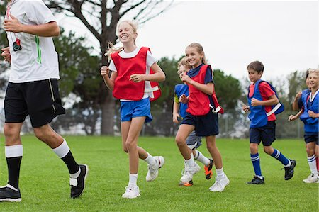 football team - Coach training children on field Stock Photo - Premium Royalty-Free, Code: 649-06040319