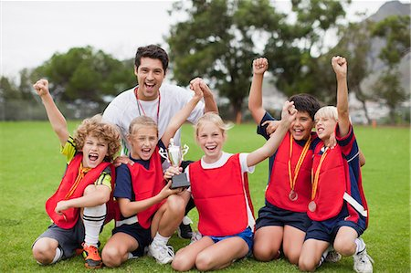 football team - Children cheering with coach Stock Photo - Premium Royalty-Free, Code: 649-06040320