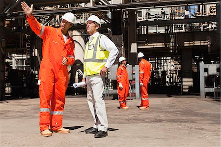 refinery - Workers talking at oil refinery Stock Photo - Premium Royalty-Free, Code: 649-06040355