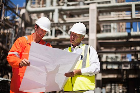 refinery - Workers with blueprints at oil refinery Stock Photo - Premium Royalty-Free, Code: 649-06040359