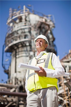 refinery - Worker with blueprints at oil refinery Stock Photo - Premium Royalty-Free, Code: 649-06040366