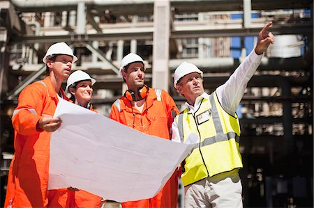 refinery - Workers with blueprints at oil refinery Stock Photo - Premium Royalty-Free, Code: 649-06040362