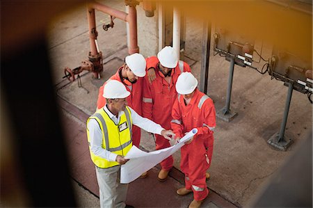 refinery - Workers with blueprints at oil refinery Stock Photo - Premium Royalty-Free, Code: 649-06040370