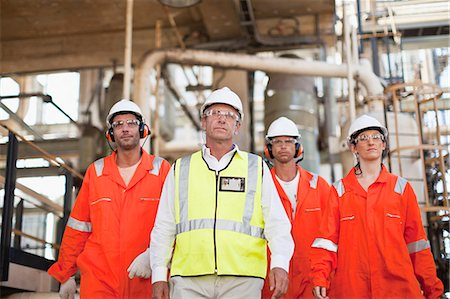 Workers walking at oil refinery Stock Photo - Premium Royalty-Free, Code: 649-06040384