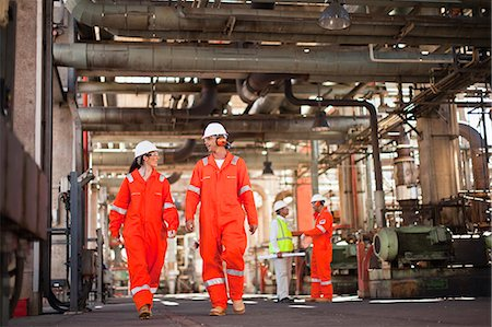 refinery - Workers walking at oil refinery Stock Photo - Premium Royalty-Free, Code: 649-06040396