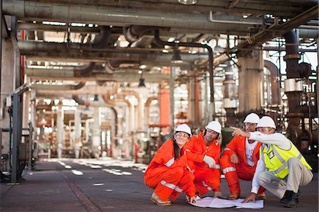 refinery - Workers with blueprints at oil refinery Stock Photo - Premium Royalty-Free, Code: 649-06040393