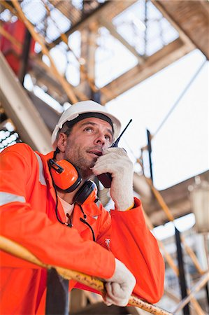 refinery - Worker with walkie talkie on site Stock Photo - Premium Royalty-Free, Code: 649-06040400