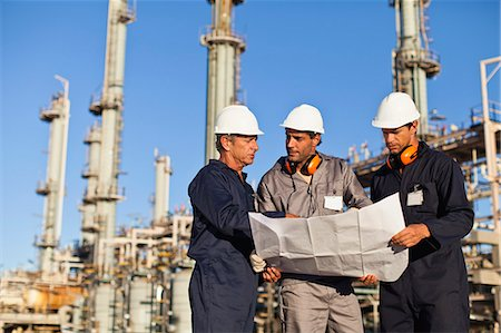 refinery - Workers with blueprints at oil refinery Stock Photo - Premium Royalty-Free, Code: 649-06040416