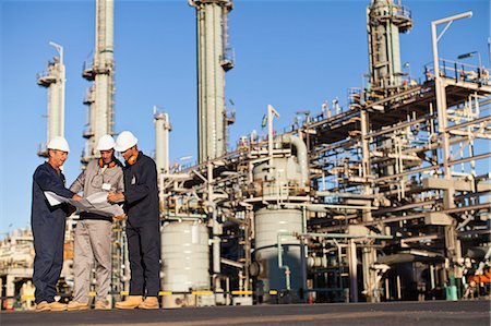 refinery - Workers with blueprints at oil refinery Stock Photo - Premium Royalty-Free, Code: 649-06040417