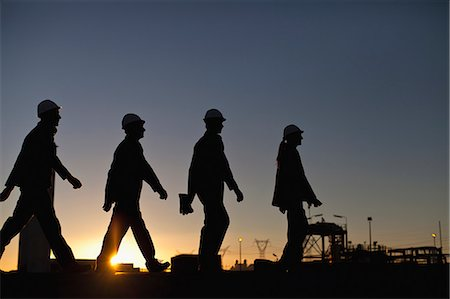 refinery - Silhouette of workers at oil refinery Stock Photo - Premium Royalty-Free, Code: 649-06040428