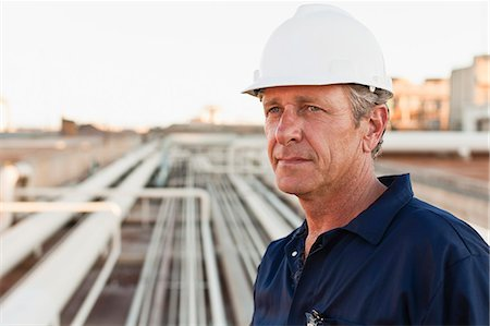 refinery - Close up of worker at oil refinery Stock Photo - Premium Royalty-Free, Code: 649-06040421