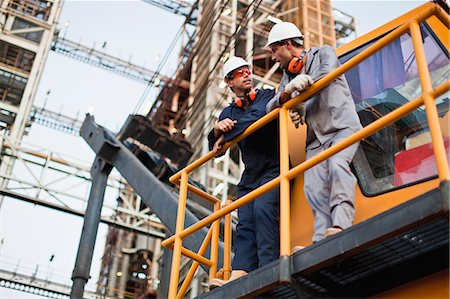 platform - Workers talking at oil refinery Stock Photo - Premium Royalty-Free, Code: 649-06040434