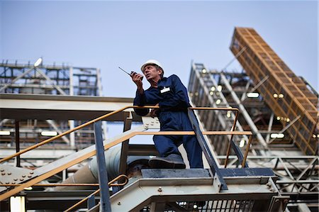 platform - Worker using walkie talkie on site Stock Photo - Premium Royalty-Free, Code: 649-06040437