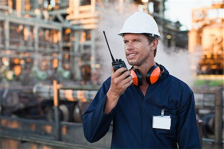 refinery - Worker using walkie talkie on site Stock Photo - Premium Royalty-Free, Code: 649-06040430