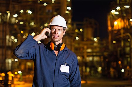 refinery - Worker on cell phone at oil refinery Stock Photo - Premium Royalty-Free, Code: 649-06040447