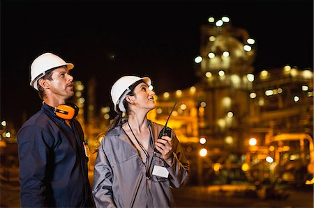 refinery - Workers talking at oil refinery Stock Photo - Premium Royalty-Free, Code: 649-06040448