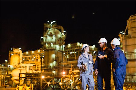 refinery - Workers talking at oil refinery Stock Photo - Premium Royalty-Free, Code: 649-06040449