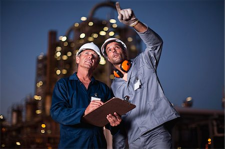 refinery - Workers talking at oil refinery Stock Photo - Premium Royalty-Free, Code: 649-06040442