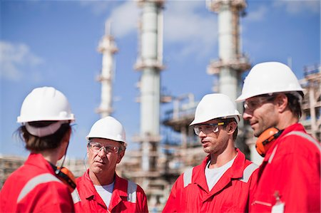 refinery - Workers talking at oil refinery Stock Photo - Premium Royalty-Free, Code: 649-06040458