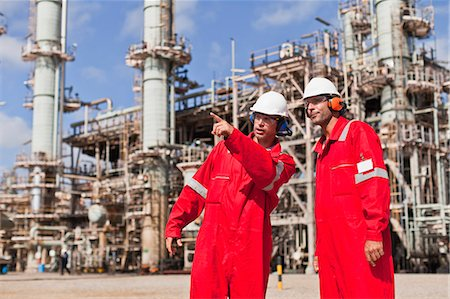 refinery - Workers talking at oil refinery Stock Photo - Premium Royalty-Free, Code: 649-06040451